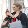 Woman-using-a-phone-while-shopping